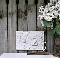 Decorative wall decor using numbers on a reclaimed wood board. White distressed spray paint.....Easy Farmhouse Style Project. #ad #RapidFuse #DiywithDap #farmhousestyle by mandy