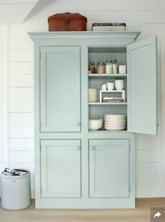 Mint predicted to be popular colour for 2016 furniture -Country Living Placed in your dining room, this cabinet made to look like a freestanding armoire will make quite the statement, while offering up a creative storage solution for dishes. Farmhouse Decor, Freestanding Kitchen, Home, Armoire, Beach House Decor, Painted Furniture, Cabinet, Furniture, Free Standing Kitchen Cabinets