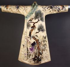 Woman's robe of embroidered white satin, Chinese, 1920s, KSUM 1983.1.772.