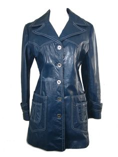 A mod vintage coat from the 1960's made in a classic chic style. It is soft, rich blue, authentic leather that is accented in striking white top-stitching with a touch of Western detailing on the back and bodice. It has a wide lapel and collar, belted sleeves, and double patch pockets accented in white top-stitching. To top it off it has mod silver-tone buttons. It is fully lined. No makers tag. Size tag with extra button inside. Just gorgeous!