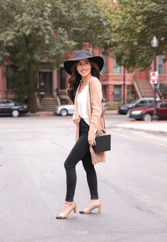 Fall cardigan outfit ~ how to style a long duster sweater on petite women. Also wearing black skinny jeans + box purse + wool hat + cap toe pumps