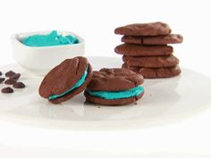 Chocolate Sandwich Cookies from FoodNetwork.com - Can change the coloring of the frosting for game day dessert!