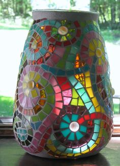 Swirly Flower Mosaic Vase- made using glass vase, sanded grout, stained glass and ?  I've bookmarked it so there should be addl info if I click on it.  This vase was sold on Etsy which describes the size and what was used to make it.