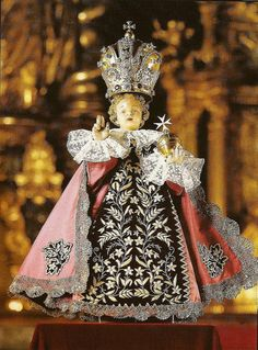 "Infant Jesus of Prague: Carmelite friary was plundered & the image of the Infant of Prague was thrown into a pile of rubbish... Forgotten for 7 years, its hands broken off, until it was found again in 1637 by Fr Cyrillus... While praying before the statue, Fr Cyrillus heard a voice say, ""Have pity on me,& I will have pity on you. Give me my hands,& I will give you peace. The more you honor me, the more I will bless you""... Claims of blessings & healings been made by many who petitioned…"