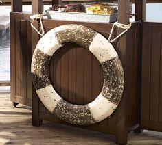 I think I'll get this for my house, when I move.  But I'm going to put a mirror behind it, maybe one that has been weathered.  How cool would that be for a beachy house?
