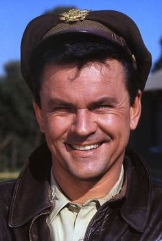 Bob Crane is U.S. Army Air Force Colonel Robert E.Hogan, senior ranking P.O.W. officer - he thrived on highly complex and seemingly impossible covert operations using less-than-conventional methods to achieve success - he was a master of manipulation, especially with Klink & Shultz - he was a charming lady's man with all the women he came into contact with - in real life, he was noted for his charismatic personality and quick-witted humor - he could play the drums