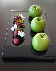 #fruit #amenity  Black fruit amenity platter, with inlets for fruit presentation! Designed by Glass Studio for Southern Sun Abu Dhabi. See more designs for hotel amenity platters at  http://the-glass-co.com/glass-dinnerware/amenity-tray/