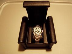 WSOP WORLD SERIES OF POKER STAINLESS STEEL MAN'S SWEDA WATCH AND LEATHER CASE.