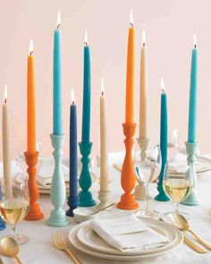 This arresting centerpiece idea offers festive color and ambience that will last for hours. Purchase brightly hued taper candles that coordinate with your wedding's palette, then spray-paint wooden candleholders of varying heights to match them.