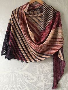 This wrap is HUGE! I don't think I blocked it hard but it's enormous! and I love it - Fantastic drape too - a really fab knit - this pattern is excellent! C1 is Blood on the Tarmac C2 ...