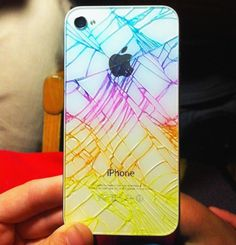 Since my iPhone broke like this, I can use this tutorial. So helpful  What to do with a shattered phone: Just draw all over the back with a highlighter and rub the excess ink off with a paper towel. The ink will stay in the cracks, but rub off the rest of the back. To avoid dangerous glass shards or ink rubbing off, cover with one piece of clear packing tape or something similar, like clear nail polish.