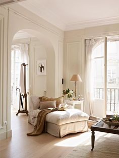 LOVE this open space, the huge arched doorway and the FABulous windows