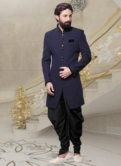 Buy Navy Blue Dhoti Style Indo Western Sherwani online from the wide collection of indowestern-sherwani. This Blue colored indowestern-sherwani in Blended Cotton fabric goes well with any occasion. Shop online Designer indowestern-sherwani from cbazaar at the lowest price.