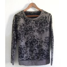 Floral Crew Neck Floral crew neck sweater in a black and grayish tone. Great condition! Like new and soft. Size reads medium but would also be perfect for a small Forever 21 Sweaters Crew & Scoop Necks