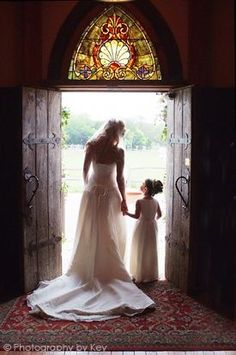 wedding photo ideas -bride and flowergirl at entry