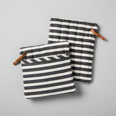 Keep your hands safe and your kitchen style flawless with these Striped Potholders from Hearth & Hand™ with Magnolia. This set of two potholders features a classic black and white striped design with a hint of rustic style — a leather loop for hanging storage features the Hearth & Hand house logo and a small copper accent. These beautifully designed black and white potholders are perfect for protecting your hands when serving up a meal for a holiday or a traditional...