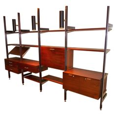 George Nelson for Herman Miller CSS Wall Unit | From a unique collection of antique and modern shelves at https://www.1stdibs.com/furniture/storage-case-pieces/shelves/