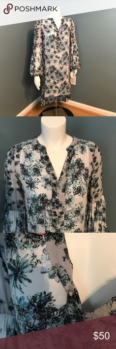 Free People Peacekeeper floral print shirt dress Rayon shirt dress. Long sleeve floral print. Hi lo style. No slip included. Dress only. Sleeves are elastic at wrist. Size tag missing. Bust measures 18 inches flat. Shoulder to front hem is 36 inches. No rips, snags or tears. Preowned. Free People Dresses Long Sleeve