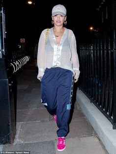 Step it up a notch in hot pink statement sneakers like Rita  Click 'visit' to buy it now   #DailyMail