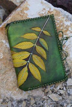 A6 pocketbook journal with hand carved and coloured ash leaf design Skyravenwolf