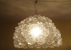 Transform Soda Bottle Bottoms Into a Chandelier | Made + Remade