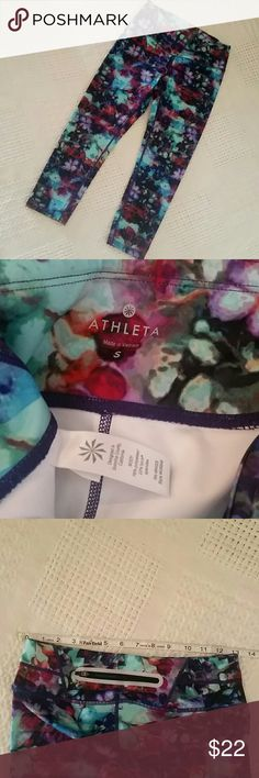 Athleta colorful floral athletic tights small Athleta athletic tights, floral multi color print, back reflective zip pocket, pull on with adjustable tie band, Polyester spandex blend, gently used, Athleta Pants Track Pants & Joggers