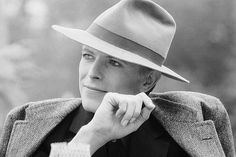 Bowie styles with a fedora.