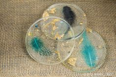 Drinks have never had a lovelier place to set than on these DIY coasters. Simply add your pretties to a coaster mold—we used feathers, jewels and gold leaf—and pour resin on top. Then sprinkle on some glitter—it will naturally sink to the bottom.