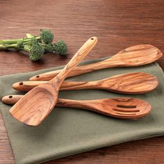 Olive Wood Kitchen Utensil Set, 4 piece  Smooth, richly-grained olive wood from Sicily, preferred for long-life durability, and beautiful as servers on the table.