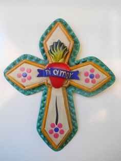 """hand punched tin cross with the sacred heart and a banner that says """"mi amor"""" :D"""