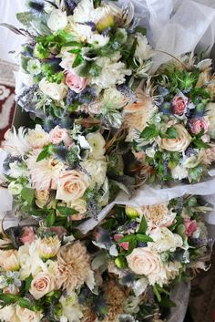 French country themed bouquets with lavender and feather accents