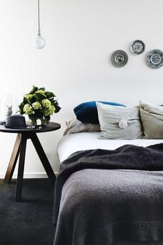 bedroom-romantic-grey-bedside-table-flowers-Inside Out oct11. Dark grey carpet. Love the bedside table