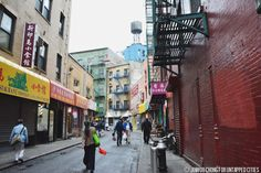 """Doyers Street, one of the oldest and most unusual streets in all of Manhattan. It is one of only a handful in the entire city that curves, a testament to its age and longevity. Its history, however, is less than savory, to the point where it was colloquially known as the """"Bloody Angle"""""""