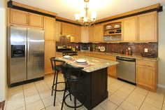 2 tone kitchen with maple cabinets