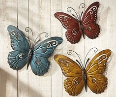 """Nature Inspired Metal Butterfly Decorative Wall Art Trio, Hang Indoors Or Outdoors Description Credit the artistry of nature for this colorful, detailed 3-pc. set of wall art. For use outdoors or inside. Crafted of painted iron with hook on the back for hanging. Largest: 17 1/2""""L x 14""""H. Material Type: Iron No Risk Purchase, Hassle-Free Returns - 100% Satisfaction Guaranteed With customer satisfaction as our number one priority, we proudly offer a Satisfaction Guarantee for all of our…"""