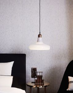 The Shadow Solo Glass lamp by BROKIS above the Trio side table by NERI & HU