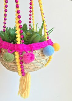 DIY hanging planter made with recycled Mardi Gras beads, pompom fringe and a tassel by Jennifer Perkins #JenniferPerkins #diy #diyproject #crafts #crafty #CreateEveryday #DoItYourself