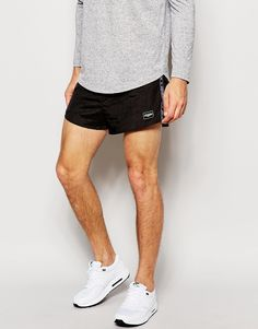 """Shorts by Jaded London Lightweight, woven nylon Stretch waistband Tapping to the side Side pockets Logo patch to hem Slim fit - cut closely to the body Machine wash 100% Nylon Our model wears a size Medium and is 188cm/6'2"""" tall"""