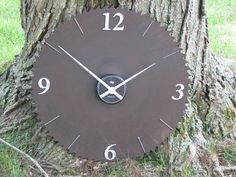 This clock is made from an old antique saw blade and has a front mounted clock mechanism for ease of changing the battery. The clock hands and numbers (3, 6, 9 & 12) are silver and the rest of the numbers are marked by silver finishing nails. At 24 in diameter, this clock is sure to be a focal point in your room! Shipping will be at buyers expense. Please message us for a quote.