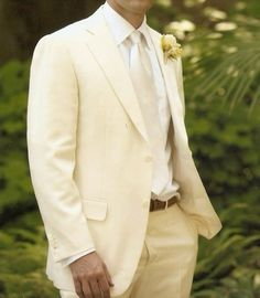 I like the idea of the groom wearing white. Of course, in my wedding the flower would be red. And the belt black. :)