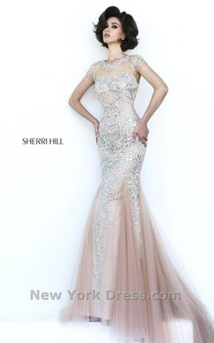 Dazzle and shine in this radiant evening dress from Sherri Hill 1939. The illusion bodice has elegant cap sleeves and shines with a stunning array of sparkling