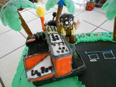 Street Paver Cake:  My brother is a public works supervisor for the City of La Mesa (California).  His crew is responsible for the maintenance of residential streets.  For his 50th birthday, my sister made this cake with him on his street paver.