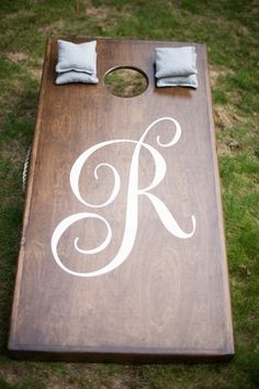 Cocktail hour game idea - wooden corn hole with elegant monogram  {Brit Perkins Photography}
