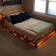 Talk about 'mood lighting'! This is one of the easiest DIY bed projects you can do! Some pallets, a mattress, a couple of lights and voila! Easy as 1-2-3! It's amazing how pallets can serve many purposes by simply putting them together -- just like these illuminated pallet beds! All you have to do is know how manypallets you need to get, arrange them and stick LED strips underneath! Warm white lights are perfect to help you get to sleep at night. Some people on the other hand pre...