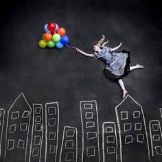 { COOL! faux skyscrapers photo prop: chalk & balloons.  what a great idea! }