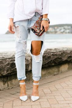 ripped denim and heels, embellished clutch