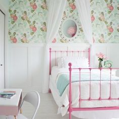 Girly aqua and pink room featuring Anthropologie wallpaper and painted vintage bed.