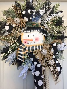 Wreath measures 26 inches! Designed with mesh, ribbons, and all the trimmings! All wreath materials are wired or/and glued with durable