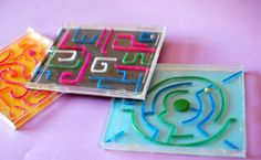 Dust off your old empty CD cases to create a homemade labyrinth game!