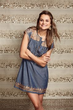 Charming chambray with detailed embellishments.